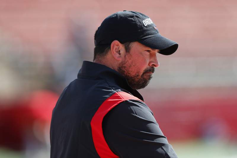 Ohio State head coach Ryan Day watches warm ups before an NCAA college football game against Rutgers, Saturday, Oct. 2, 2021, in Piscataway, N.J. (AP Photo/Noah K. Murray)