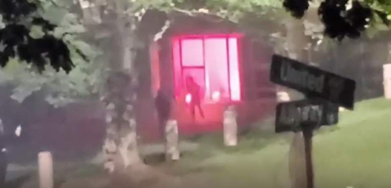 A screen grab of the video appears to show the moment of protester lit a firework and threw it inside the building.  Video by Kimberly Krautter.