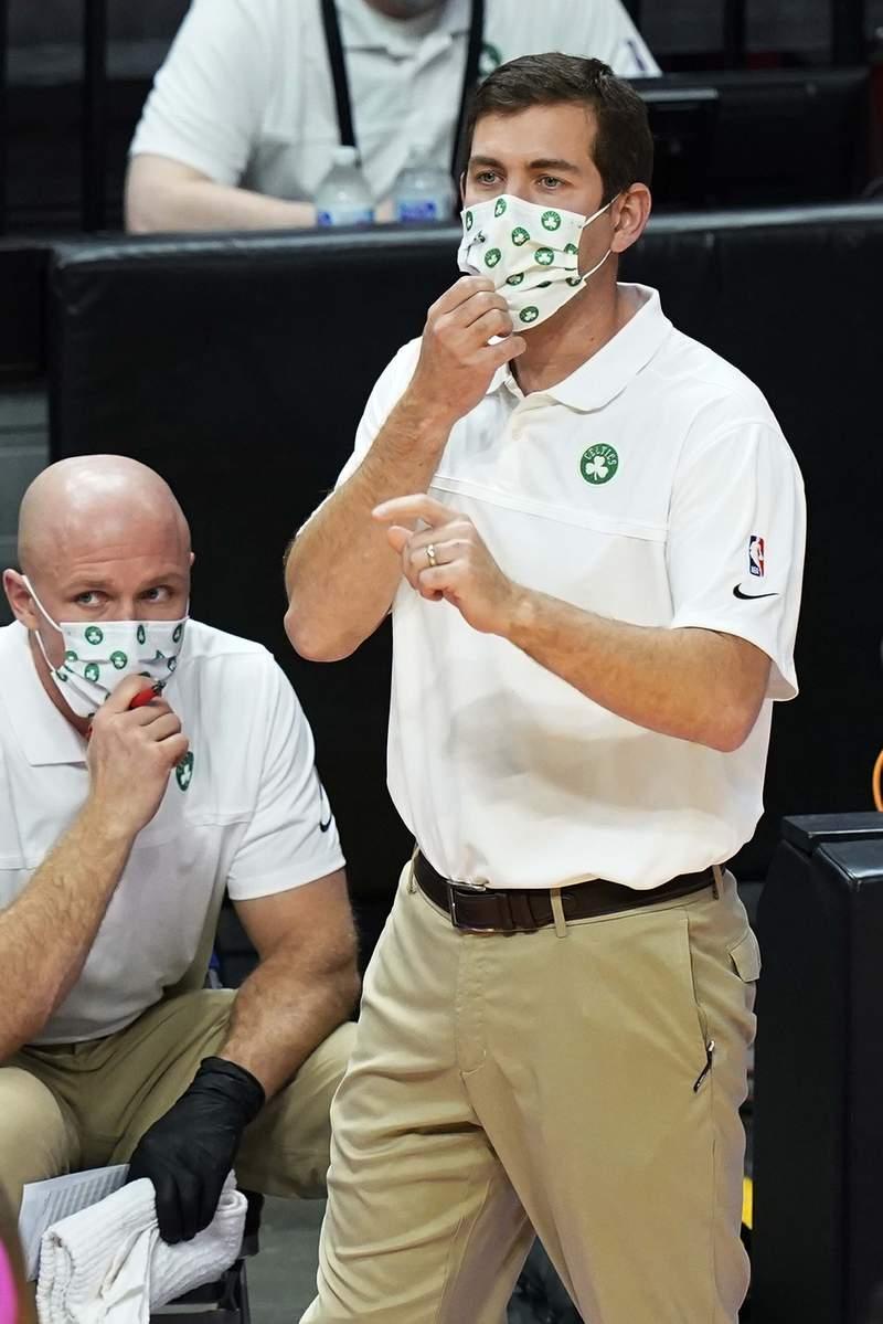 Boston Celtics head coach Brad Stevens gestures during the first half of an NBA basketball game against the Miami Heat, Wednesday, Jan. 6, 2021, in Miami. (AP Photo/Marta Lavandier)