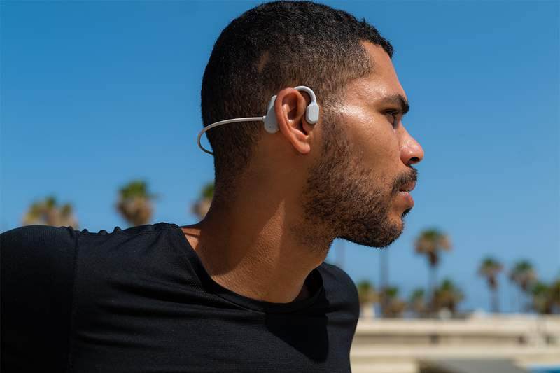 Unlike traditional headphones and earbuds, these open-ear headphones rest outside your ears, playing audio directly through your ear canal.
