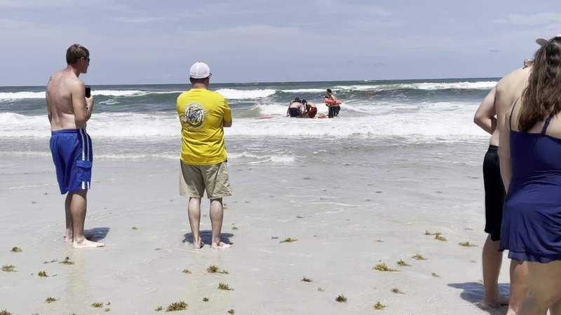 Lifeguards on Sunday rescued four people from the surf at St. Augustine Beach near Ocean Hammock Park.