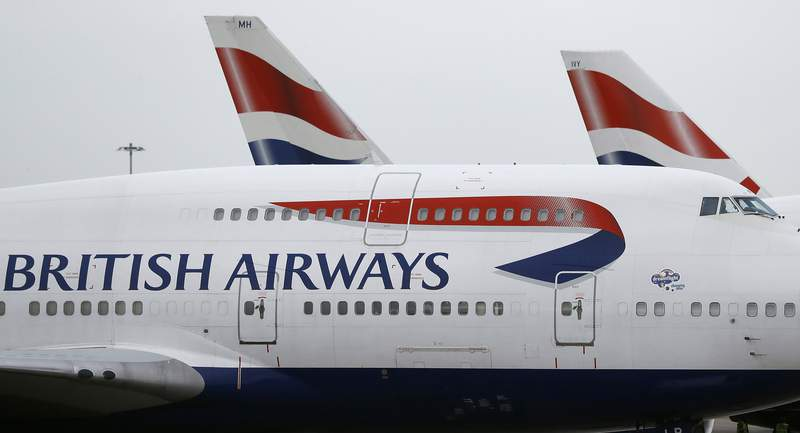 FILE - In this Tuesday, Jan. 10, 2017, file photo, British Airways planes are parked at Heathrow Airport in London. A British Airways plane flew between New York and London in less than five hours, landing early Sunday, Feb. 9, 2020, at Heathrow Airport after leaving John F. Kennedy International Airport, setting a record for subsonic plane travel. (AP Photo/Frank Augstein, File)