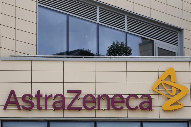 "FILE - In this Saturday, July 18, 2020 file photo a general view of AstraZeneca offices and the corporate logo in Cambridge, England. Scientists at Oxford University say their experimental coronavirus vaccine has been shown in an early trial to prompt a protective immune response in hundreds of people who got the shot. ""We are seeing good immune response in almost everybody,"" said Dr. Adrian Hill. Hill said Oxford has partnered with drugmaker AstraZeneca to produce their vaccine globally, and that the company has already committed to making 2 billion doses. (AP Photo/Alastair Grant, File)"