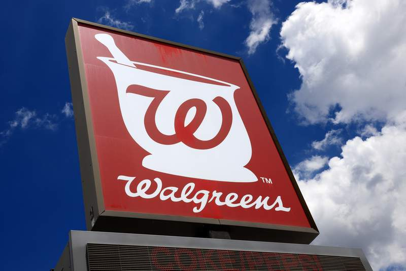 FILE - This June 25, 2019, file photo shows a sign outside a Walgreens Pharmacy in Pittsburgh.  On Thursday, Jan. 7, 2021, Walgreens Boots Alliance lost $308 million in its first fiscal quarter due to a big charge tied to its ownership stake in the drug wholesaler AmerisourceBergen. The drugstore chain also saw COVID-19 continue to eat away at its business, particularly in the United Kingdom, but the companys overall performance topped Wall Street expectations.   (AP Photo/Gene J. Puskar, File)