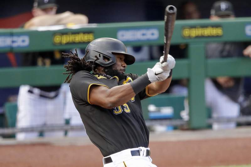 FILE - In this July 22, 2020, file photo, Pittsburgh Pirates' Josh Bell bats during an exhibition baseball game against the Cleveland Indians in Pittsburgh. The Pirates traded the slugging first baseman to Washington on Thursday, Dec. 24, 2020, for pitching prospects Will Crowe and Eddy Yean. (AP Photo/Gene J. Puskar, File)