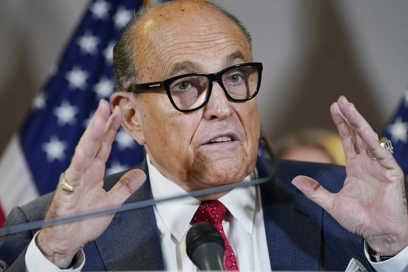 FILE - In this Nov. 19, 2020, file photo, former New York Mayor Rudy Giuliani speaks during a news conference at the Republican National Committee headquarters in Washington. Federal agents raided Giulianis Manhattan home and office on Wednesday, April 28, 2021, seizing computers and cellphones in a major escalation of the Justice Departments investigation into the business dealings of former President Donald Trumps personal lawyer. (AP Photo/Jacquelyn Martin, File)