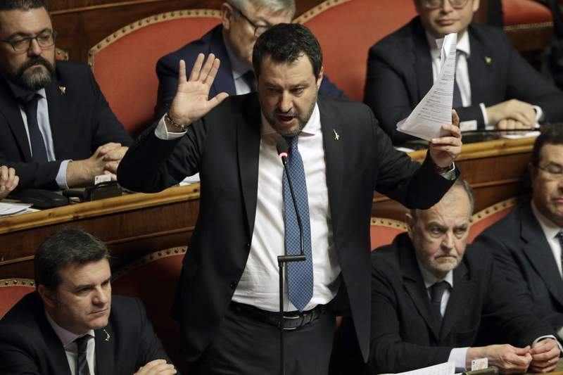 FILE - In this Feb. 12, 2020 file photo, then opposition leader Matteo Salvini speaks at the end of the debate at the Italian Senate on whether to allow him to be prosecuted, as he demands to be, for alleging holding migrants hostage for days aboard coast guard ship Gregoretti instead of letting them immediately disembark in Sicily, while he was interior minister, in Rome. A judge in Sicily on Saturday, April 17, 2021, ordered former Interior Minister Matteo Salvini to stand trial for having refused to let a Spanish migrant rescue ship dock in an Italian port in 2019, keeping the people at sea for days. (AP Photo/Andrew Medichini, file)