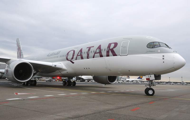 FILE - In this Jan. 15, 2015 file photo, a new Qatar Airways Airbus A350 approaches the gate at the airport in Frankfurt, Germany. Qatar Airways said Thursday, Aug. 5, 2021, that it has grounded 13 Airbus A350s over degradation of the plane's fuselage, further escalating a monthslong dispute with the European airplane maker. (AP Photo/Michael Probst, File)