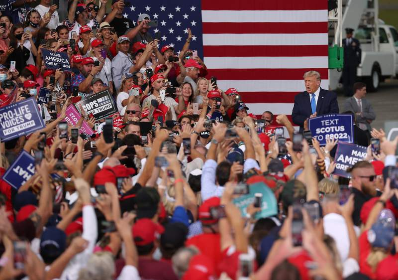 JACKSONVILLE, FLORIDA - SEPTEMBER 24:  President Donald Trump arrives on stage during his, 'The Great American Comeback Rally', at Cecil Airport on September 24, 2020 in Jacksonville, Florida. President Trump continues to campaign against Democratic Presidential Candidate Joe Biden. (Photo by Joe Raedle/Getty Images)