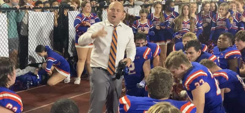 Bolles football coach Matt Toblin talks to his team following a 10-7 overtime win over Gadsden County in the Class 4A state semifinals.