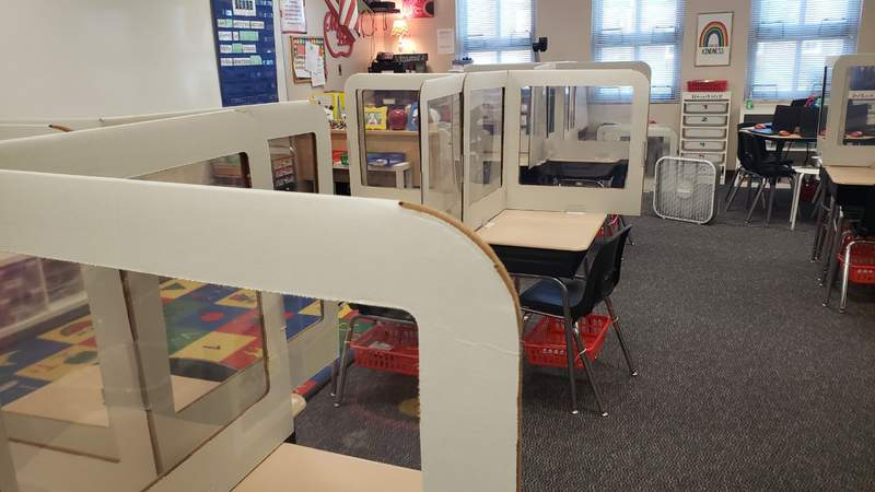 Desks with COVID-19 dividers in a St. Johns County school