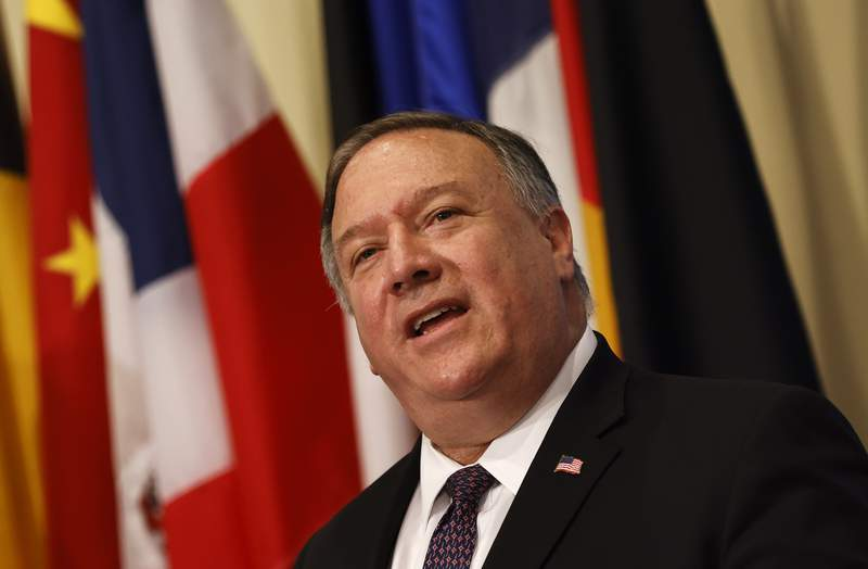 Secretary of State Mike Pompeo speaks to reporters following a meeting with members of the U.N. Security Council, Thursday, Aug. 20, 2020, at the United Nations. The Trump administration has formally notified the United Nations of its demand for all U.N. sanctions on Iran to be restored, citing significant Iranian violations of the 2015 nuclear deal.  (Mike Segar/Pool via AP)