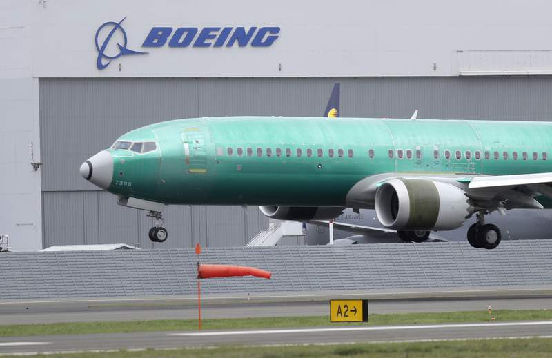 FILE - In this April 10, 2019, file photo a Boeing 737 MAX 8 airplane being built for India-based Jet Airways lands following a test flight at Boeing Field in Seattle.  Boeing says it lost $2.40 billion in the second quarter, and it's taking a more downbeat view about the airplane market because of the coronavirus outbreak. Boeing said Wednesday, July 29, 2020, it now expects the airline industry will take longer to recover from the pandemic, and that will limit aircraft sales. (AP Photo/Ted S. Warren, File)
