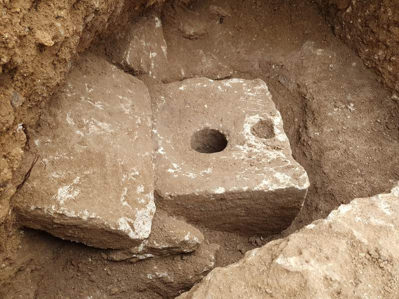 In this photo provided by Israel Antiquities Authority shows a rare ancient toilet in Jerusalem dating back more than 2,700 years Jerusalem, when private bathrooms were a luxury in the holy city, Tuesday, Oct. 5, 2021. The Israeli Antiquities Authority said on Tuesday that the smooth, carved limestone toilet was found in a rectangular cabin that was part of a sprawling mansion overlooking what is now the Old City. (Yoli Schwartz/Israel Antiquities Authority via AP)