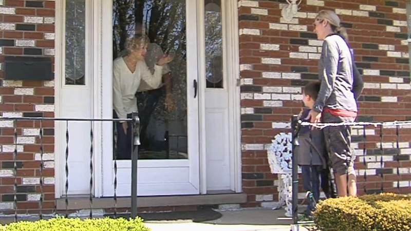Waving at grandchildren through glass