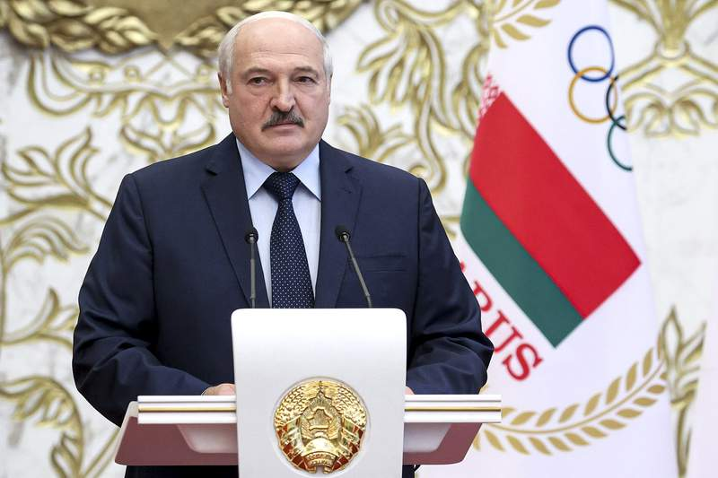 FILE - In this Friday, July 9, 2021 file photo, Belarus President Alexander Lukashenko addresses members of Belarus National Olympic team ahead of the Summer Olympics Games in Tokyo, Minsk, Belarus. Belarus' authorities on Monday July 19, 2021, raided offices of an independent newspaper and detained three of its journalists as part of a continuing crackdown on media outlets and civil society activists. (Maxim Guchek/BelTA Pool Photo via AP, File)