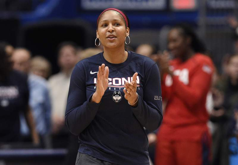 FILE - In this Jan. 27, 2020, file photo, former Connecticut and Minnesota Lynx player Maya Moore applauds in Hartford, Conn. Moore has married Jonathan Irons, the Missouri man she helped work to free from prison after a 22-year-old wrongful conviction. (AP Photo/Jessica Hill, File)