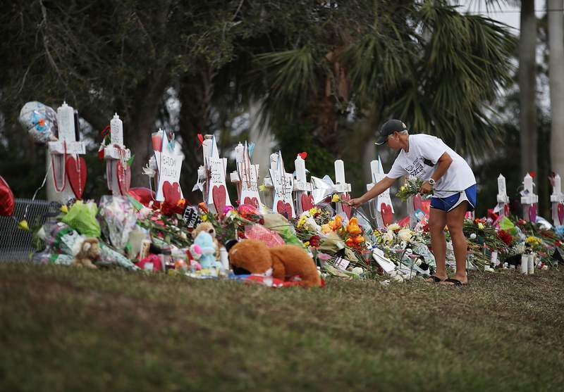 Melissa Shev visits a memorial set up in front of Marjory Stoneman Douglas High School. This was taken Feb. 20, 2018.