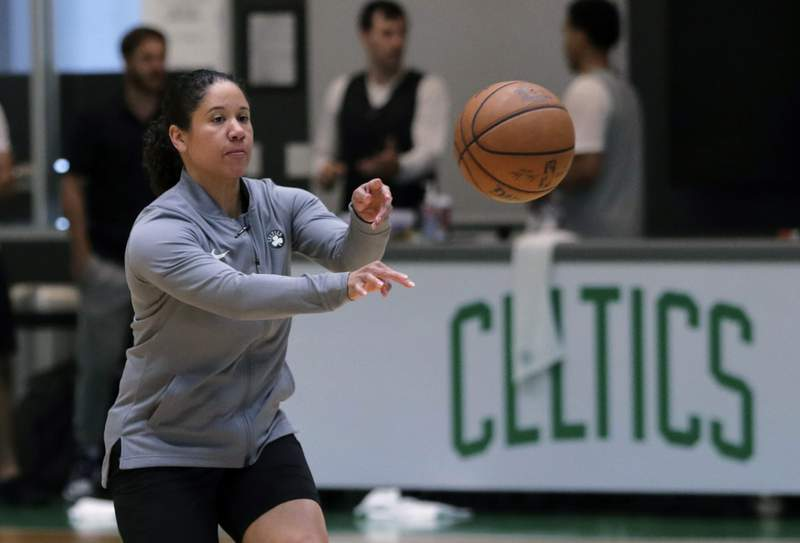 FILE - In this July 1, 2019, file photo, Boston Celtics assistant coach Kara Lawson passes the ball at the team's training facility in Boston. A person familiar with the situation says Duke is in talks with Boston Celtics assistant coach and former WNBA All-Star Lawson to lead the Blue Devils womens basketball program. The person spoke to The Associated Press on condition of anonymity Friday, July 10, 2020, because the school has not commented publicly on its search. (AP Photo/Charles Krupa, File)