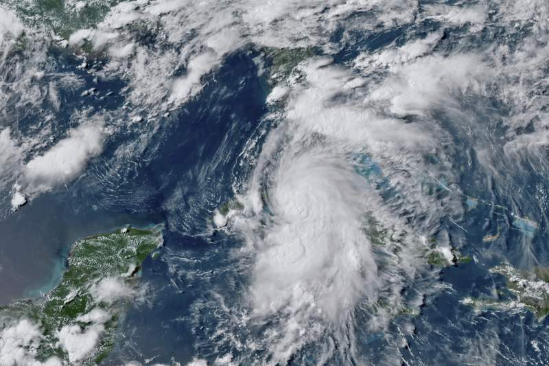 This GOES-16 GeoColor satellite image taken Monday, July 5, 2021, at 4:50 p.m. EDT, and provided by NOAA, shows Tropical Storm Elsa over western Cuba with strong rain and winds. Forecasters say it will move on to the Florida Keys on Tuesday and Floridas central Gulf coast by Wednesday. The storm is moving over mainly rural areas to the east of Havana on Monday after making landfall near Cienega de Zapata, a natural park with few inhabitants. (NOAA via AP)