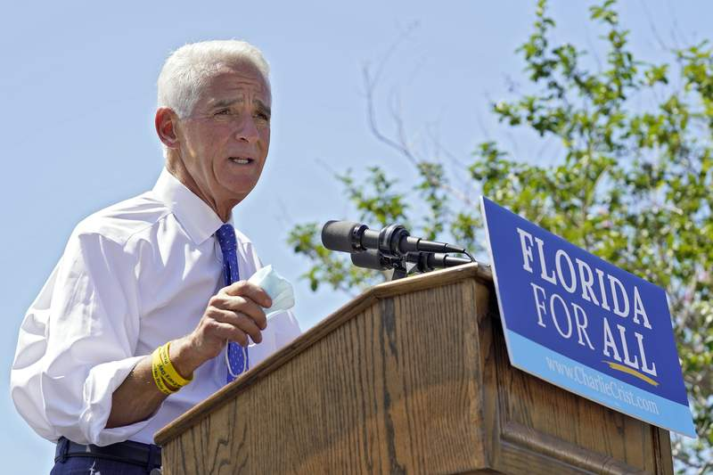 FILE - In this May 4, 2021, file photo Rep. Charlie Crist, D-St. Petersburg, gestures during a campaign rally as he announces his run for Florida governor in St. Petersburg, Fla. (AP Photo/Chris O'Meara, File)