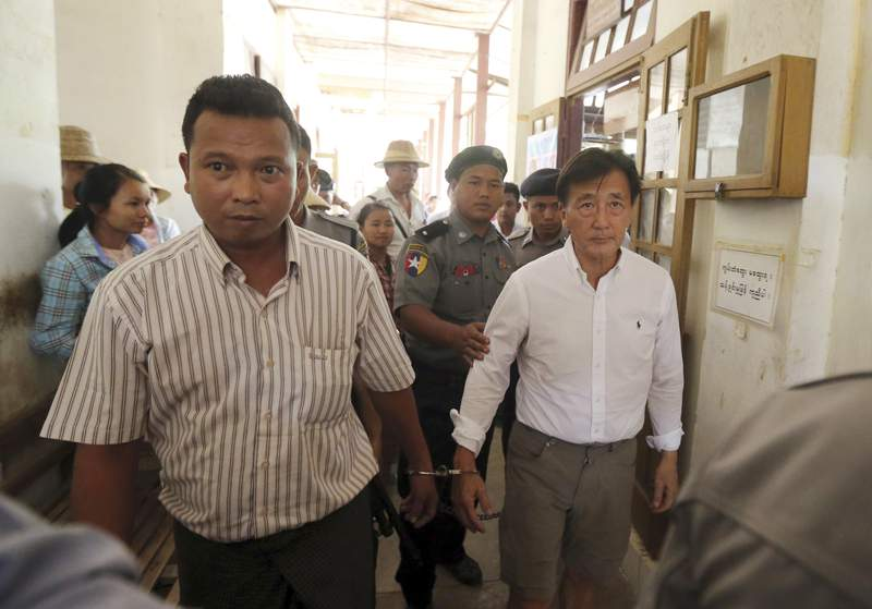 FILE - In the May 7, 2019, file photo, Myanmar national Shein Latt, left, and his boss U.S. national John Fredric Todoroki leave a local court after being arrested for operating a marijuana plantation in Ngazun Township, Mandalay region, central Myanmar. A Myanmar court on Tuesday sentenced Shein Latt to twenty years in prison under the country's drug laws concerning marijuana. (AP Photo/Aung Shine Oo, File)
