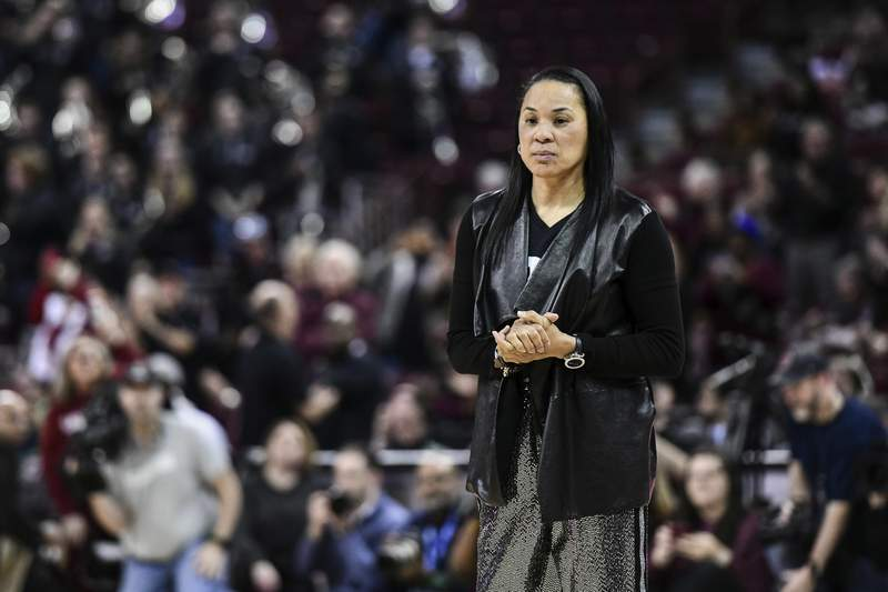 South Carolina head coach Dawn Staley stands on the court before an NCAA college basketball game Sunday, March 1, 2020, in Columbia, S.C. South Carolina defeated Texas A&M 60-52. (AP Photo/Sean Rayford)