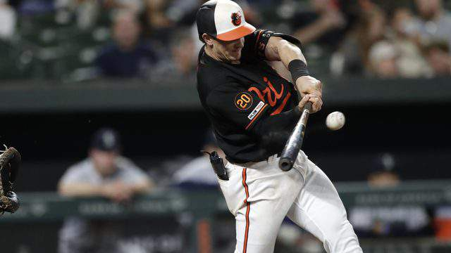 Baltimore Orioles' Austin Hays swings at a pitch during the eighth inning of a baseball game against the Seattle Mariners on Sept. 20, 2019. (AP Photo/Julio Cortez)