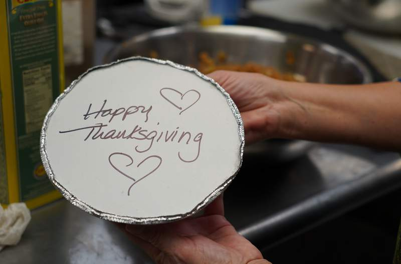 Volunteers prepare individual Thanksgiving meals for seniors in Hawthorne, N.J., on Nov. 3, 2020. With a fall surge of coronavirus infections gripping the U.S., many Americans are forgoing tradition and getting creative with celebrations. (AP Photo/Kathy Young)
