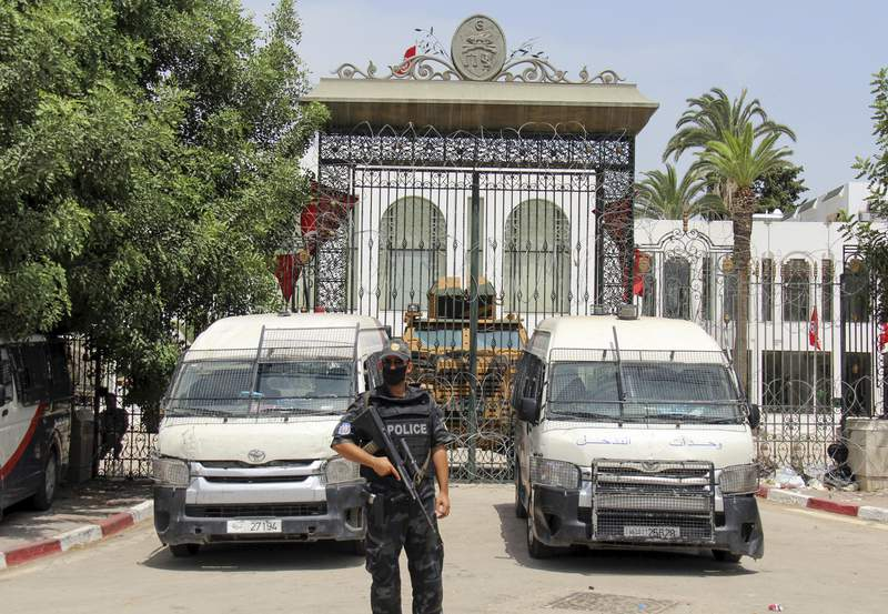 Police cars and a subject   armored unit   bearer  artifact  the entranceway  of the Tunisian parliament successful  Tunis, Tuesday, July 27, 2021. The Ennahda party, has called for dialogue, pursuing  President Kais Saeid's sacking of the premier  curate  and suspension of parliament connected  Sunday. (AP Photo/Hassene Dridi)