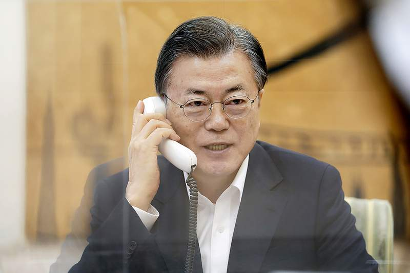 In this photo provided by South Korea Presidential Blue House, South Korean President Moon Jae-in talks on the phone with U.S. President Joe Biden at the presidential Blue House in Seoul, in South Korea, Thursday, Feb. 4, 2021. Moon said Thursday he and President Joe Biden have agreed to further bolster their countries' alliance and work together to achieve peace on the Korean Peninsula.(South Korea Presidential Blue House via AP)