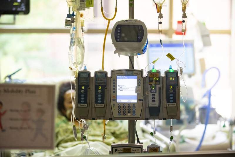 A pregnant COVID-19 patient rests in the Medical Intensive care unit (MICU) at St. Luke's Boise Medical Center in Boise, Idaho on Tuesday, Aug. 31, 2021. Idaho Gov. Brad Little activated the National Guard on Tuesday to assist state hospitals. (AP Photo/Kyle Green)