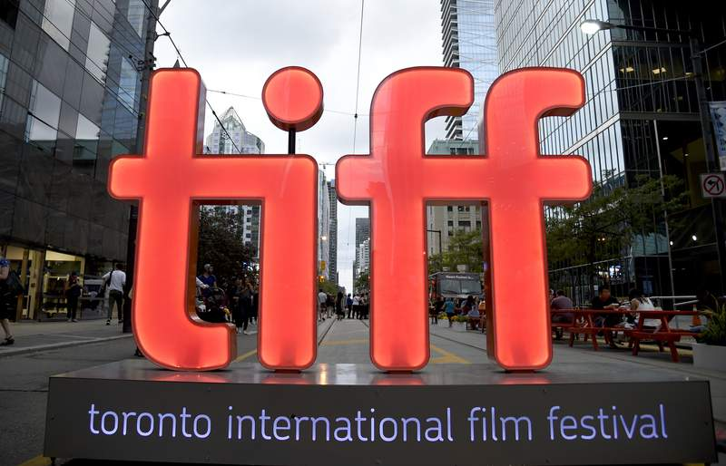 FILE - In this Thursday, Sept. 6, 2018, file photo, a view of a festival sign appears on Day 1 of the Toronto International Film Festival in Toronto.  Organizers announced Tuesday, July 20, 2021, that among the films that premiere at this years TIFF will be the adaptation of the Tony-winner Dear Evan Hansen, which will open the festival, Edgar Wrights 60s London themed Last Night in Soho, and The Eyes of Tammy Faye. TIFF runs Sept. 9-18.  (Photo by Chris Pizzello/Invision/AP, File)
