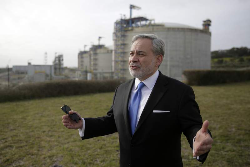 United States Secretary of Energy Dan Brouillette gestures during an interview at the LNG terminal of the deepwater port of Sines after visiting the port, in Sines, southern Portugal, Wednesday, Feb. 12, 2020. The US government and american companies are expressing interest in the expansion of the port. (AP Photo/Armando Franca)