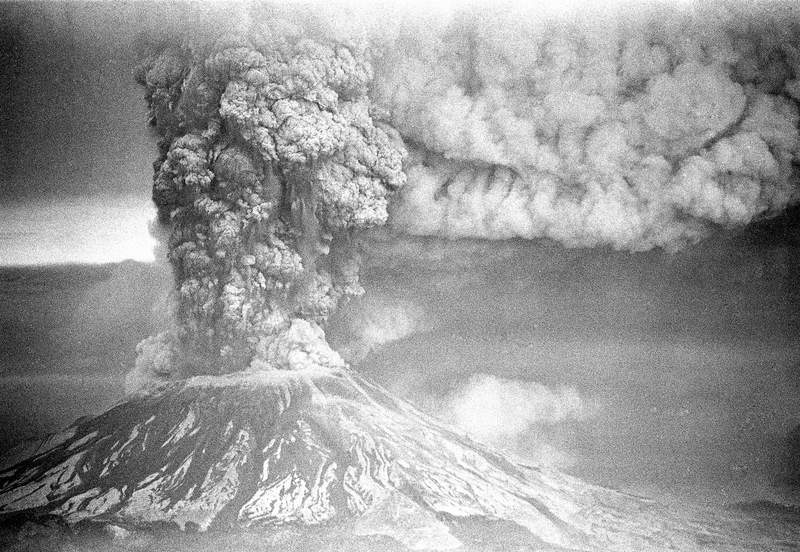 FILE - In this May 18, 1980, file photo, Mount St. Helens sends a plume of ash, smoke and debris skyward as it erupts.  May 18, 2020, is the 40th anniversary of the eruption that killed more than 50 people and blasted more than 1,300 feet off the mountain's peak.