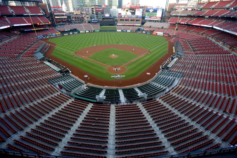Empty seats are viewed in Busch Stadium as St. Louis Cardinals starting pitcher Jack Flaherty throws in the first inning baseball game against the Pittsburgh Pirates in St. Louis. Major League Baseball players rejected a proposal to delay the start of spring training and the season due to the coronavirus pandemic, vowing Monday, Feb. 1, 2021, to report under the original schedule. (AP Photo/Jeff Roberson, File)