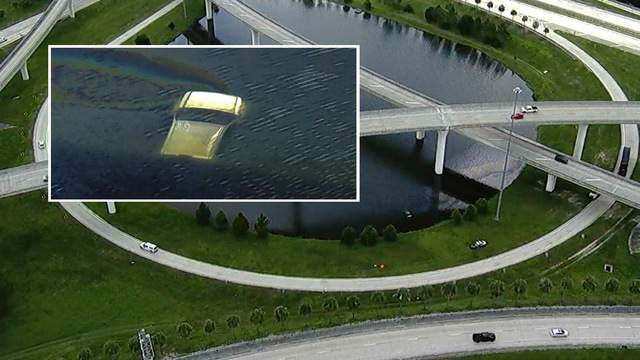Images from Sky4 over pickup truck in Southside retention pond.