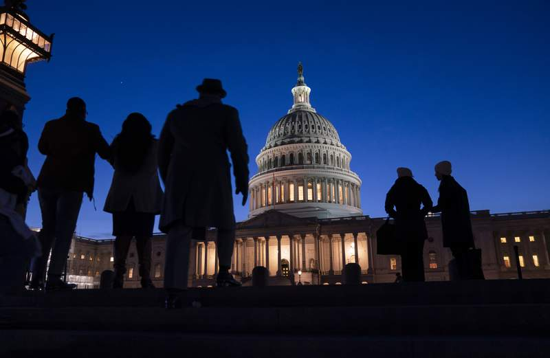 FILE - In this Jan. 22, 2020 file photo, night falls on the Capitol, in Washington during the impeachment trial of President Donald Trump. For all the gravity of a presidential impeachment trial, Americans dont seem to be giving it much weight. Web traffic and TV ratings tell a similar story, with public interest seeming to flag after the House voted last month to impeach a president for only the third time in U.S. history.  (AP Photo/J. Scott Applewhite, File)