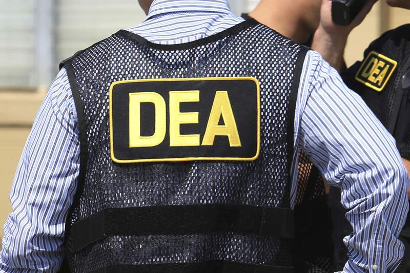 FILE - This June 13, 2016 file photo shows Drug Enforcement Administration agents in Florida. Federal investigators took the unusual step of wiretapping a retired supervisor in the U.S. Drug Enforcement Administrations Miami office for at least three months in 2019 as part of an inquiry into whether sensitive case information was leaked to attorneys for suspected drug traffickers in Colombia, current and former law enforcement officials told The Associated Press. (Joe Burbank/Orlando Sentinel via AP, File)
