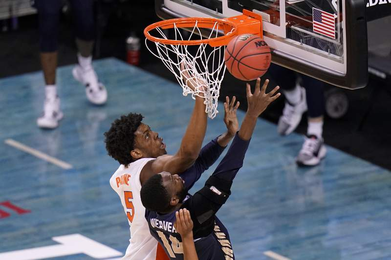 Oral Roberts forward DeShang Weaver (14) shoots ahead of Florida forward Omar Payne (5) during the second half of a college basketball game in the second round of the NCAA tournament at Indiana Farmers Coliseum, Sunday, March 21, 2021 in Indianapolis. (AP Photo/AJ Mast)