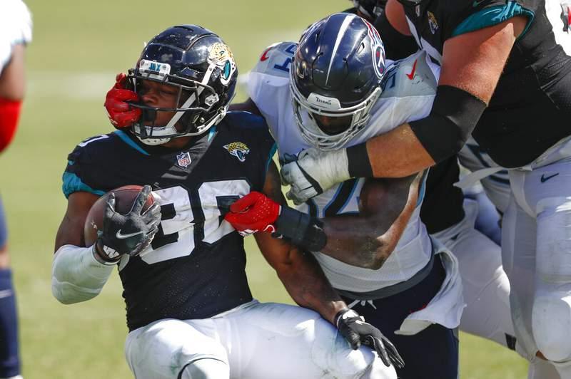 Tennessee Titans inside linebacker Rashaan Evans (54) grabs the face mask of Jacksonville Jaguars running back James Robinson (30) in the second half of an NFL football game Sunday, Sept. 20, 2020, in Nashville, Tenn. (AP Photo/Wade Payne)