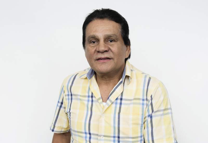 """This Aug. 4, 2016 photo shows boxer Roberto Durn posing for a portrait in New York, to promote the film, """"Hands of Stone."""" The film, about Duran and boxing trainer Ray Arcel, opens on Aug. 26. Durn, who held world championships in four weight classes during his more than three-decade career, has tested positive for the coronavirus but has had only mild symptoms so far, one of his sons said Thursday, June 25, 2020. (Photo by Taylor Jewell/Invision/AP, File)"""