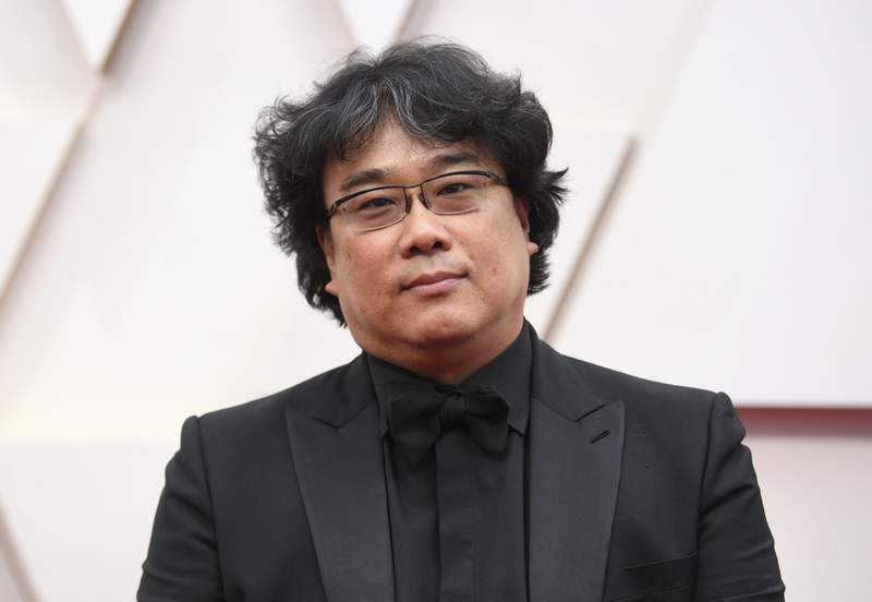 FILE - Bong Joon-ho arrives at the Oscars on Sunday, Feb. 9, 2020, in Los Angeles. The Parasite director has been selected as jury president of the 78th Venice International Film Festival, organizers said Friday. The Oscar-winner will preside over seven jurors to hand out the festivals top awards, including the prestigious Golden Lion. (Photo by Richard Shotwell/Invision/AP, File)