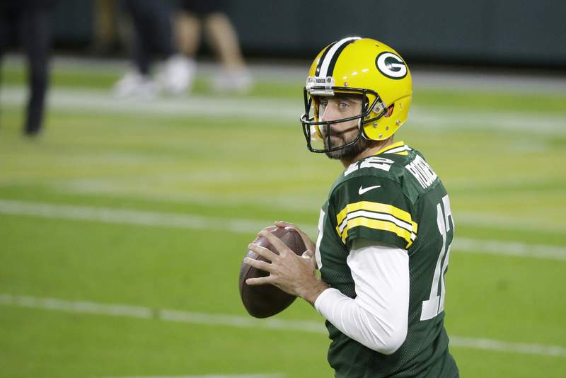 Green Bay Packers quarterback Aaron Rodgers prepares to throw before an NFL football game against the Atlanta Falcons, Monday, Oct. 5, 2020, in Green Bay, Wis. (AP Photo/Mike Roemer)