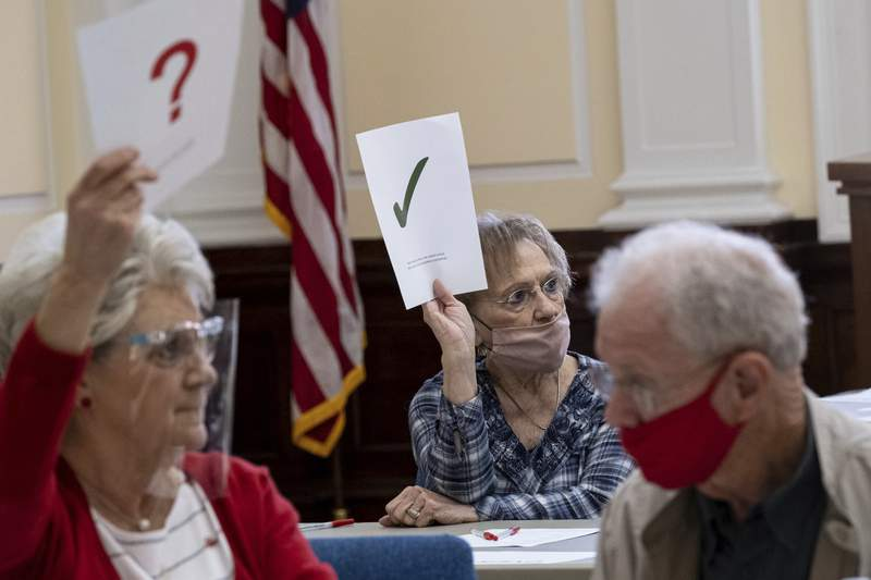 Officials sort ballots during an audit at the Floyd County administration building in Rome, Ga., on Friday morning, Nov. 13.