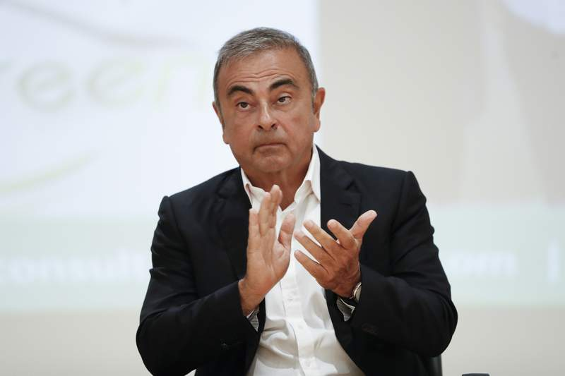 FILE - In this Sept. 29, 2020, file photo, Nissan's former executive Carlos Ghosn attends a press conference at the Holy Spirit University of Kaslik (USEK), north of Beirut, Lebanon. A civil court trial began in Japan Friday, Nov. 13, over Nissans demand for 10 billion yen ($95 million) in damages from former Chairman Ghosn over what the automaker claimed was harm it suffered from various financial misconduct.(AP Photo/Hussein Malla, File)