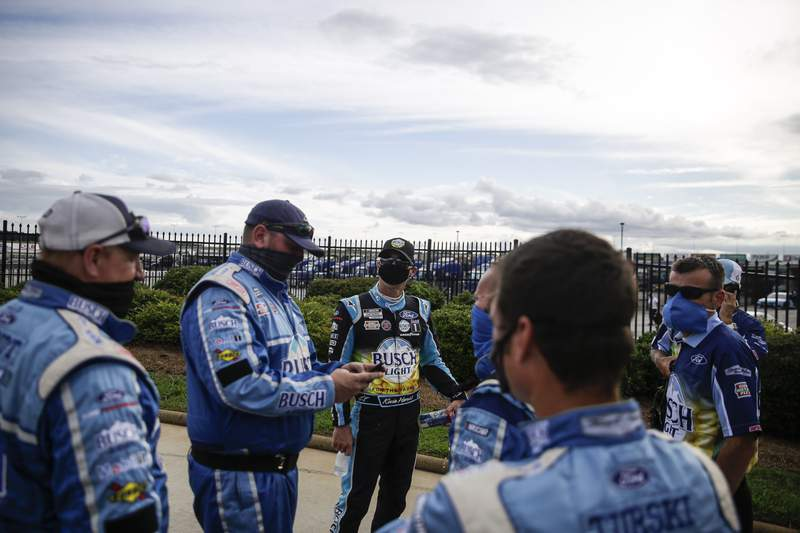 Kevin Harvick, third from left, celebrates with members of his crew after winning a NASCAR Cup Series auto race at Atlanta Motor Speedway, Sunday, June 7, 2020, in Hampton, Ga. (AP Photo/Brynn Anderson)