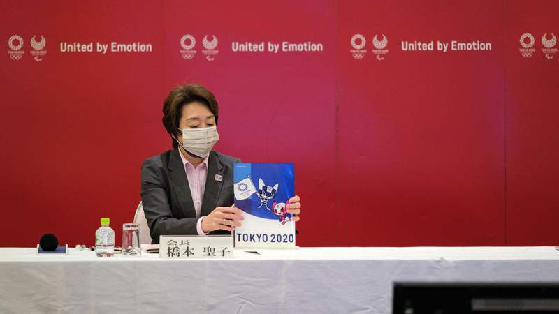 Seiko Hashimoto, President of the Tokyo 2020 Organizing Committee of the Olympic and Paralympic games holds a Tokyo 2020 folder during the Tokyo 2020 Executive Board Meeting on April 26. (Photo by Nicolas Datiche - Pool)