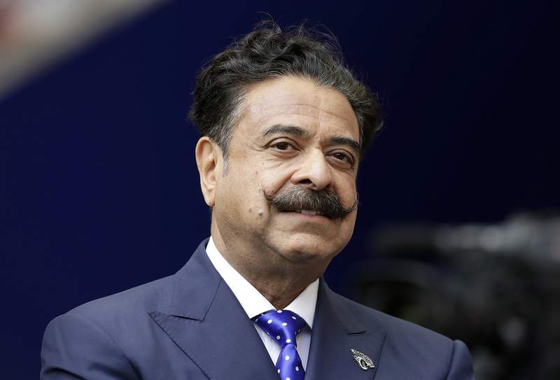 FILE - This file  Sept. 24, 2017 file photo shows Shad Khan at Wembley Stadium in London.  The Jacksonville Jaguars will play two home games in London next season, strengthening the franchises foothold in an overseas market the NFL is eager to expand. The Jaguars will play back-to-back games at historic Wembley Stadium, giving them a potential home-field advantage in the second one since they wont have to travel that week. Specific dates were not announced.(AP Photo/Matt Dunham, FILE)
