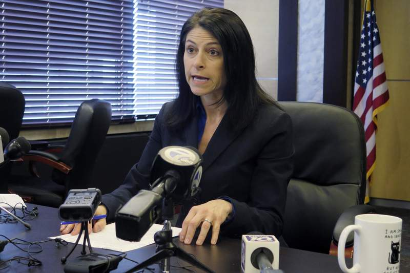 FILE - In this March 5, 2020, file photo, Michigan Attorney General Dana Nessel addresses the media during a news conference in Lansing, Mich. Jacob Wohl, 22, and Jack Burkman, 54, two notorious conservative operatives were charged Thursday, Oct. 1, 2020 with felonies in connection with false robocalls that aimed to dissuade residents in Detroit and other U.S. cities from voting by mail, Michigan's attorney general announced. (AP Photo/David Eggert, File)